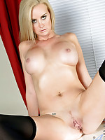 Blonde cougar Camryn Cross flaunts her big tits and spreads her legs wide open